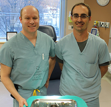 Two doctors with a surgical tray.